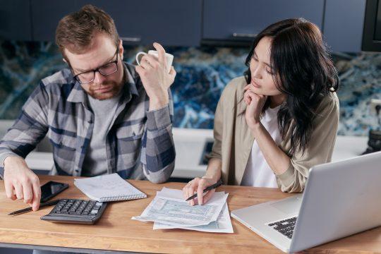 couple discuss financial requirements of spouse visa